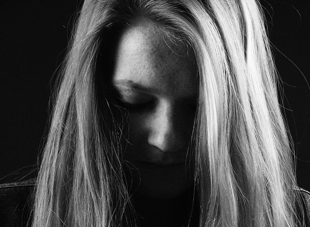 Woman sad and in emotional pain from toxic divorce