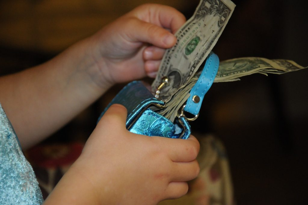 money coming out of purse to pay attorney fees