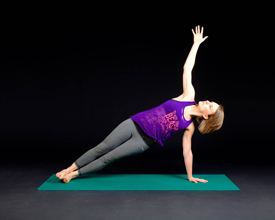 woman-exercising-yoga-side-plank
